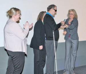 Ken Woodward receiving the International Award on behalf of BC Ferries from Lattitude's Louise Scholes (Jennifer Deeney looks on)