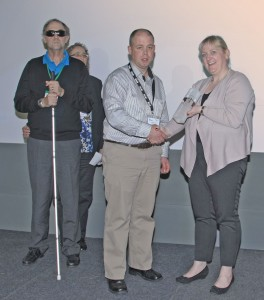 Timmy Cary of GE's Whitegate power station receiving his award from Jennifer Deeney